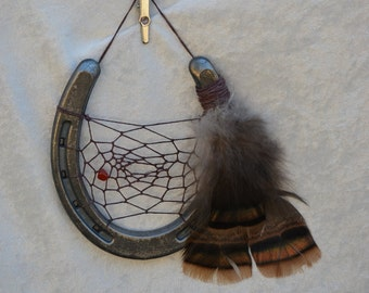 Horse shoe dream catcher with turkey feathers