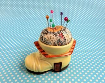 Vintage egg cup pincushion