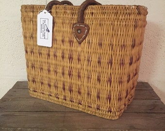 Beautiful vintage wicker basket with leather handles