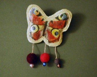 Art textile butterfly statement brooch with hand-felted wool beads in pink, purple and cream