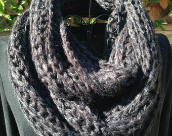 Infinity knitted scarf. Cable pattern with a little shine