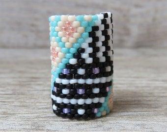 Pastel colors vs black and white stripes dreadlocks ring