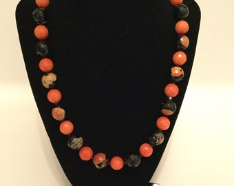 Orange and black faceted necklace