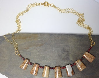 A beautiful necklace made of picture jasper trapezoids.
