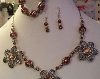 Necklace, bracelet, and earrings set.
