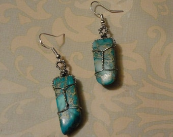 Turquoise, silver wire wrapped dangle earrings