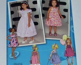 Simplicity 1924 Toddlers' And Child's Dress In Two Length With Bodice And Trim Variations Sizes:4-8