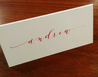 Hand written place cards - red ink on white card stock - modern script