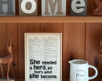 """Inspirational Quote. """"She Needed A Hero, So That's What She Became"""" Vintage Dictionary Book Page Print. Superhero Quote"""