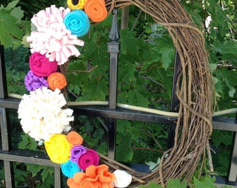 Felt flower, multi color grapevine wreath.