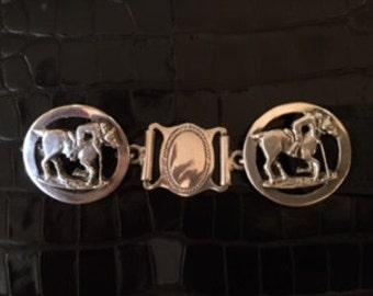 Silver 900 belt buckles