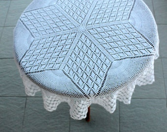 Round white crochet tablecloth with cotton yarn