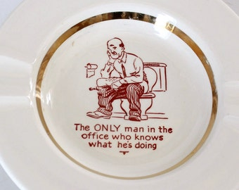 The only man in the office who knows what he's doing ashtray . vintage gag gift dish, man on toilet . office ashtray