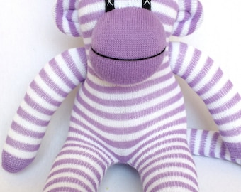 Small purple pin striped sock monkey with love hearts pom pom hat