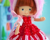 Strawberry's Pink Kitty Bonnet and Red Polka-dot Dress