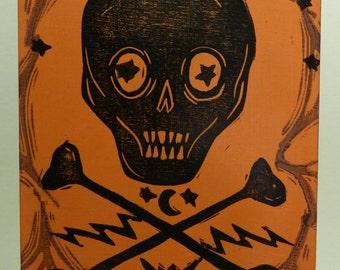 Skull and Crossbones Retro Style Orange and Black Original Halloween Linocut Art on Wooden Panel