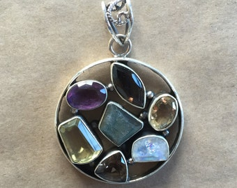 Classic pendant with labradorite, lemon citrine, opal and amethyst feature stones. Sterling silver mount   (Item # P10)