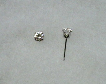 4mm White Cubic Zirconias in 925 Sterling Silver Stud Earrings