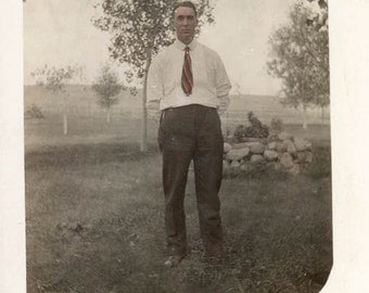 vintage photo Hand Colored Man Red Tie Hands Behind Back RPPC
