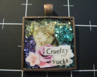 "Sassy Cat Pendant, ""Cruelty Sucks"", 50% goes to the current selected animal charity"