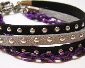 Studded Black and Purple Bracelet -Faux silver and black leather cord with metal studs, purple chain, and gothic spike charm