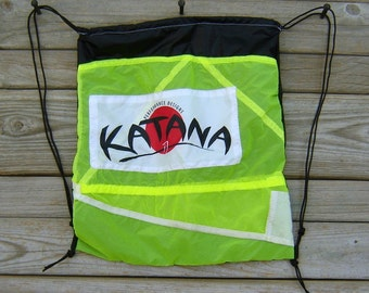 Black Drawstring Backpack with Neon Yellow Katana Parachute End Panel Applique