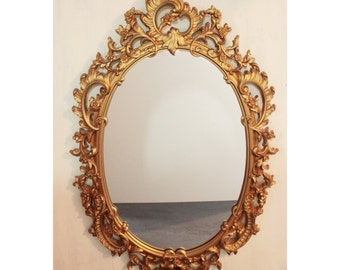 large gold mid century wall mirror - ornate oval framed mirror - Hollywood Regency