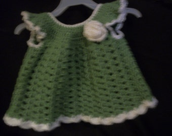 Crocheted green baby dress, buttons in back. crocheted white rose and trimmed in white.