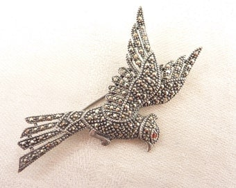 Vintage Sterling and Marcasite Deco Flying Bird Brooch with Garnet Eye