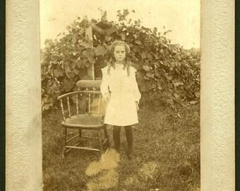 Girl in Pumpkin Patch / Antique Cabinet Photo