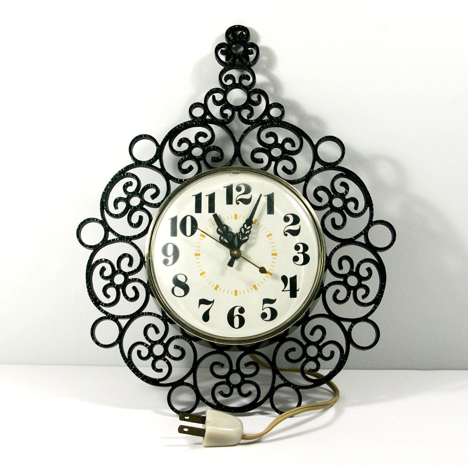 vintage electric wall clock 70s timex black wrought iron look