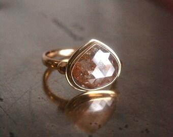 Diamond engagement ring in 14k yellow gold, 3.96 carat pear diamond slice
