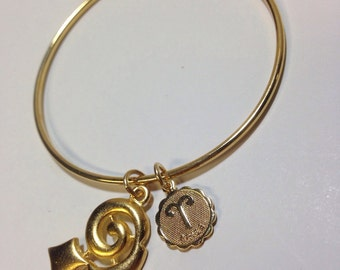 Vintage goldtone Aries zodiac tension charm bracelet
