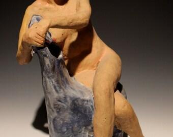 Ceramic figure sculpture, seated nude woman stoneware figurine sky chair lounging