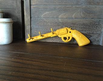 Mustard Yellow Distressed Cast Iron Gun Hook wall decor hook