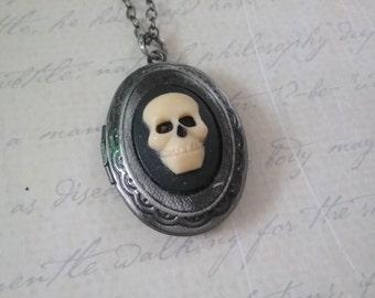 Small gunmetal skull locket