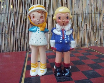 Pair of Vintage Stylized Boy and Girl Pottery Figurines