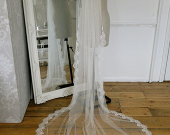 Lace edged chapel length long veil