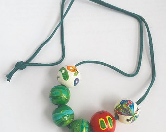 The Very Hungry Caterpillar Hand-Painted necklace, Eric Carle, butterfly cocoon