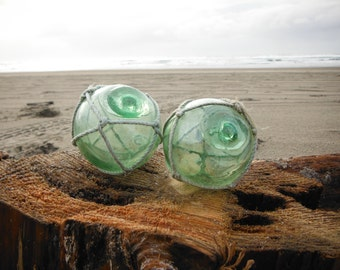 "Japanese Glass Fishing Floats - Two 2.4"" Diameter, Original Nets, Shades of Green, Kawaguchi Marks"