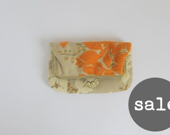 sample sale. fold over kisslock purse. orange