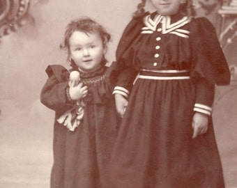 Adorable Little Girls With The Younger SISTER HOLDING On To Her DOLL Cabinet Card Photo Spokane Washington Circa 1890s