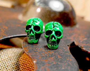 Tiny skull studs in green. Unisex earrings. Surgical steel