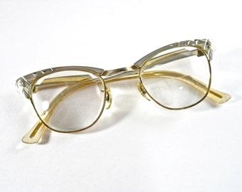 Vintage chrome cat eye glasses. Unique shiny silver aluminum metal horn rimmed frames. 1950s eyewear. 44-22 size.