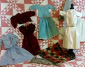 Antique Doll Quilt with Mattress and Turn of The Century Doll Clothes in Silk, Cotton, Voile and Velvet, Thirteen Pieces, c. 1900s