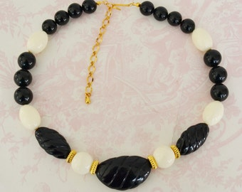 Vintage Black and White Beaded Necklace with Golden Accents