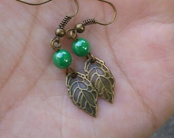 Antique brass leaf and green luster bead French hook earrings