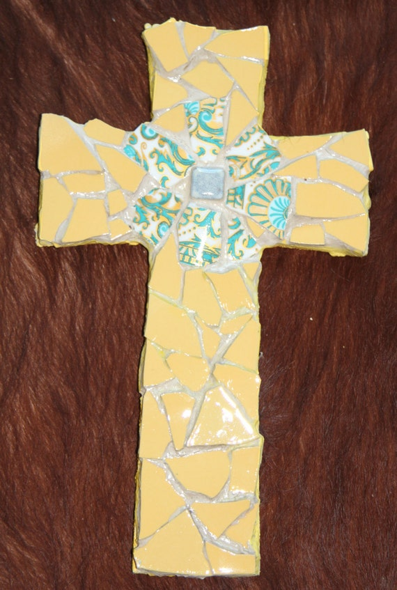 Broken dish mosaic cross in yellow with blue flower detail
