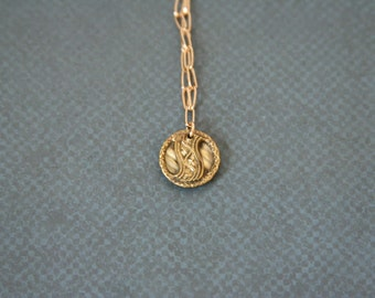 Bright Brass Necklace Small Pendant Made with a beautiful vintage metal button