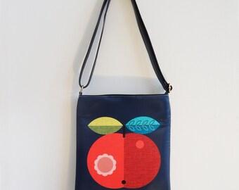 Big, red, apple sling bag